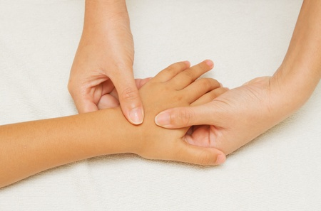 children massage with mother hand Stock Photo - 16296025