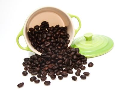 coffee bean in green pot on white background Stock Photo - 16565631