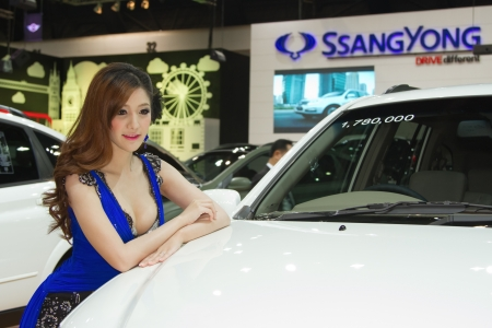 BANGKOK, THAILAND- DECEMBER 8 : Unidentified female presenter at Ssangyong  booth at The 29th Thailand International Motor Expo 2012 at Impact on December 8, 2012 in Bangkok,Thailand Stock Photo - 16769463