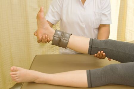 strength therapy: Rehab muscle training for leg with physical therapist Stock Photo