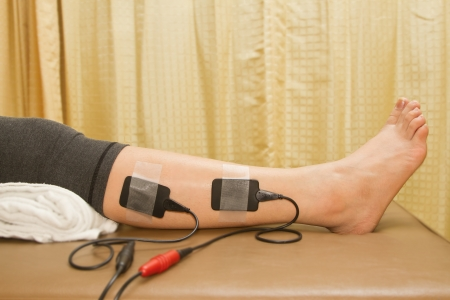 eletrical: Physical therapy , woman with eletrical stimulator for increase muscle strenght and release pain