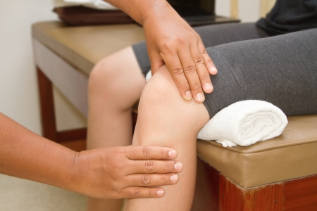 knees up: Doctor checking the knee joint