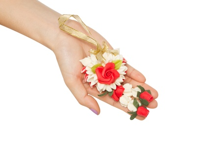 malai: woman give a Malai The flower in Thai Tradition Style,meaning for greeting and welcome