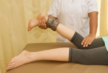 Rehab training for knee and hamstring muscle with physical therapist photo