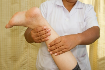 Therapist Massage of a woman's calf muscle for release pain Stock Photo - 16975489