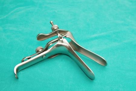 dilate: Metal Gynecologic Speculum  Stock Photo