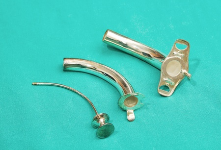 oesophagus:  silver tracheostomy tube,surgical instrument