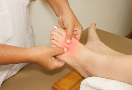 the painful or injury toe and foot,doctor examining an injury foot photo