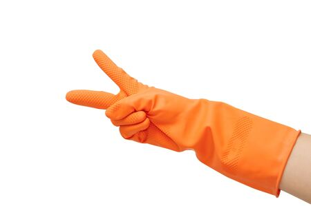 hand with orange glove display concept for victory sign on white background Stock Photo - 17414157