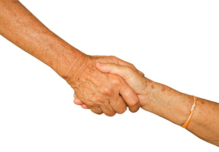 Happy Senior Adult Couple Holding Hands together on white background photo