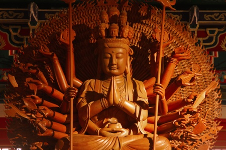 Guan Yin sculpture Thousand Hand carved of wood. photo