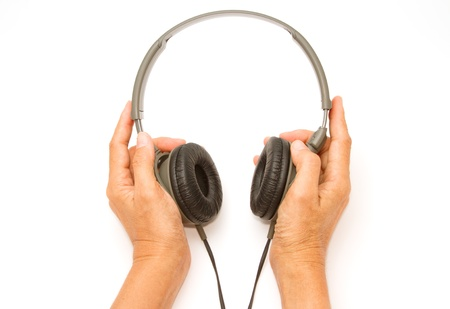 person shined:  woman hand  with headphones on white background