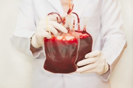 Doctor holding  fresh donor blood for transfusion photo