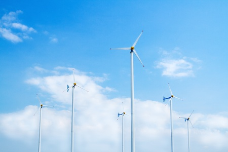 Many wind turbine generating electricity on blue sky Stock Photo - 17964532