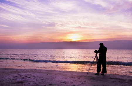 Photographer take a photo on the beach,silhouette shot photo