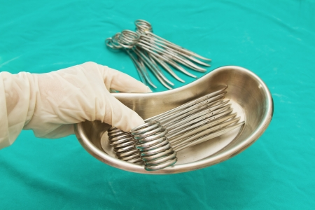 grabing: Doctor s hand grabing  Surgical Instruments tray   Stock Photo