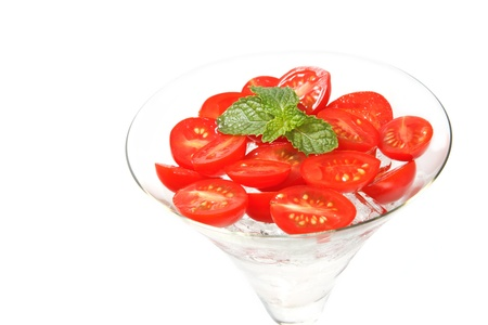 slice tomato: Slice tomato with ice in cocktail glass on with background