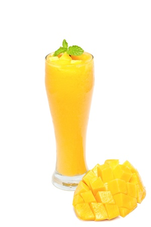 Fresh mango juice in a glass over white background photo