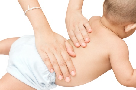 Baby back massage with mother hand photo