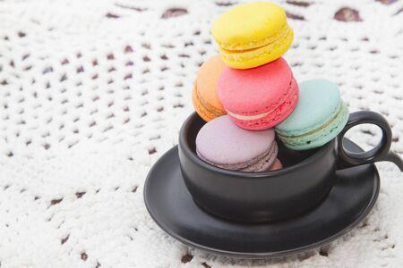 macaroon: Pastel colorful macaroon,france  macaroon in coffee cup Stock Photo