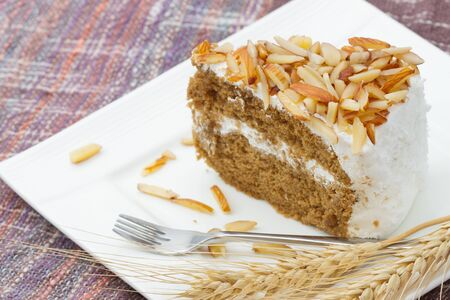 coffee almond cake , home made bakery on white dish photo