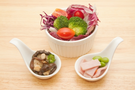 Fusion food,vegetable salad,ham and mushrooms photo