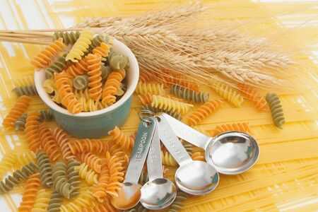 measuring spoon: Pasta and Spaghetti with measuring spoon ,Food Backgrounds