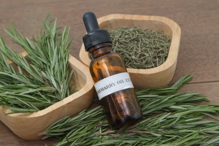 Rosemary herb and aromatherapy  essential oil dropper bottle ,for spa treatment photo