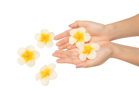 destress: Beautiful woman hand with spa candle  Stock Photo