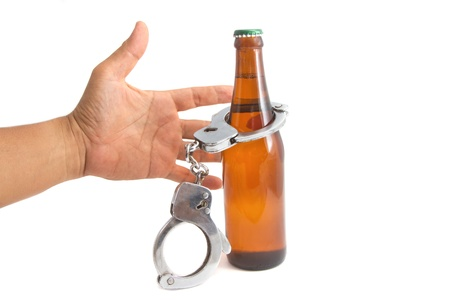 drink responsibly: bottle beer and handcuffs,Drunk driving concept