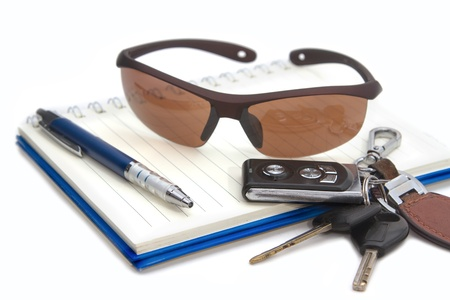 sunglasses and car key on book, concept travelling out door photo