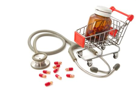 Shopping Cart with capsules and a stethoscope photo