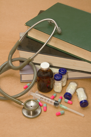 Stethoscope and  medications on medical book photo