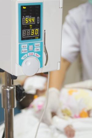 nurser: Infusion pump feeding IV drip into boy patients