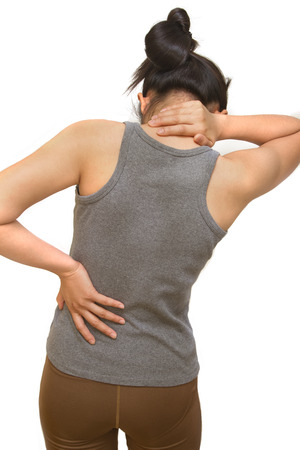 spondylosis: Attractive female  suffers from backache and neck pain Stock Photo