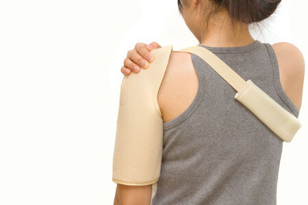 physical impairment: woman wearing a shoulder brace