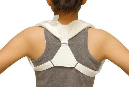 immobilize: woman wearing clavicle brace for immobilize shoulder Stock Photo