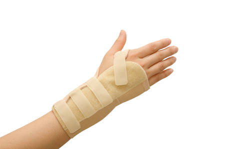 Trauma of wrist with  brace ,wrist support Stock Photo - 26241238