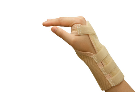 Trauma of wrist with  brace ,wrist support Stock Photo - 26241251
