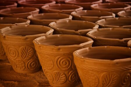 Many handmade clay pots cylinder photo
