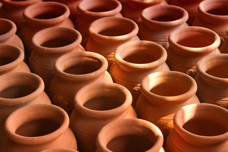 Many handmade clay pots  kept for drying photo