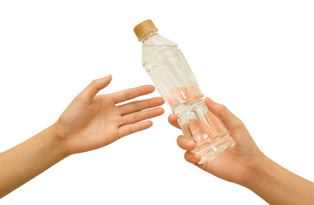 Hand Offering a Bottle of Water Stock Photo - 27464570