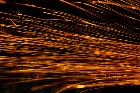 Glowing flow of sparks in the dark,Sparks background photo