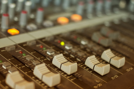 audio mixing console with faders and adjusting  photo