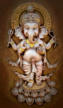 parvati: The Indian God Ganesha made from clay in low relief carving  Stock Photo