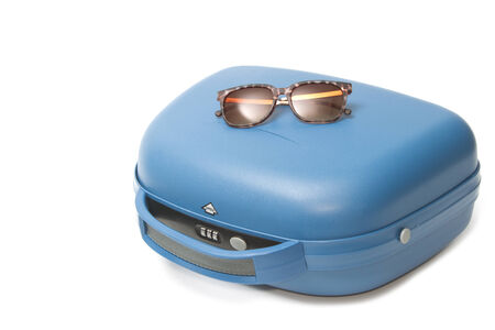 Summer travel suitcase with  sunglasses photo
