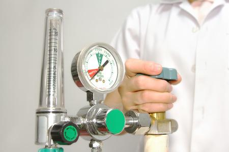 doctor is setting oxygen valve Stock Photo