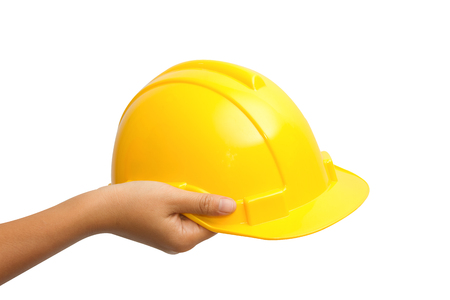 Engineer or Worker Hand Picking Yellow Safety Helmet Hat  photo