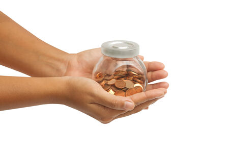 Hand holding a jar of money for retirement photo