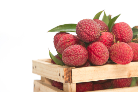 leechee: Fresh lychees with leaves in crate